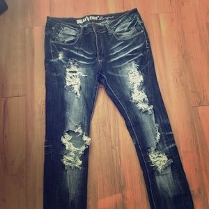 Dark distressed denim